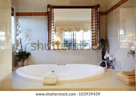 Luxurious bathroom in stylish house - stock photo