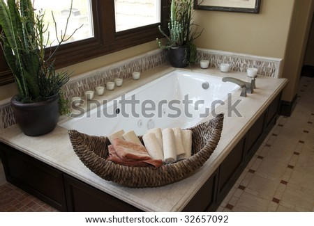Luxurious bathroom with a modern tub and stylish decor. - stock photo