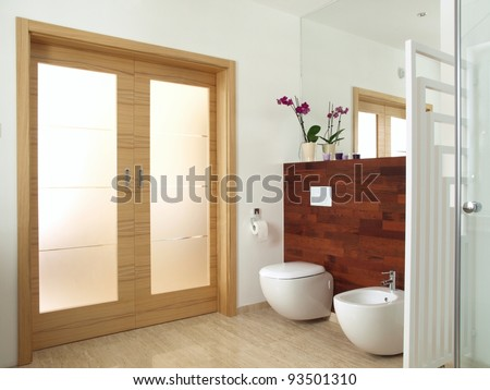 Luxurious bathroom with exotic wood and travertine - stock photo