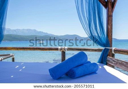 Luxurious bed by the sea - stock photo