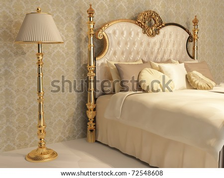 Luxurious bed with cushion and stand lamp in royal bedroom interior