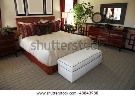 Luxurious bedroom with contemporary furniture and decor. - stock photo