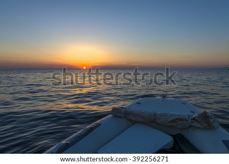 Luxurious boat sailing during sunset in Santorini, Greece.