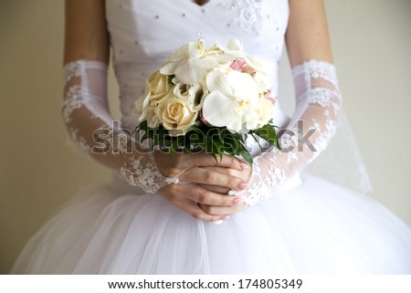 Luxurious bouquet in bride's hand - stock photo