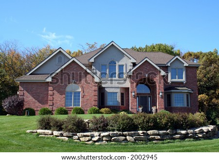 Luxurious brick executive house with blue sky - stock photo