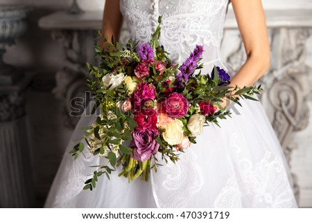 luxurious bridal bouquet of different flowers, roses, purple, pink, green, purple