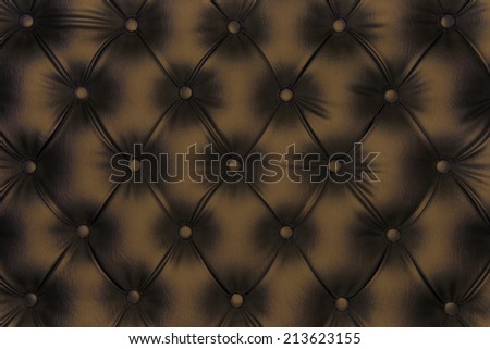 Luxurious brown-tone leather texture furniture with buttons  - stock photo