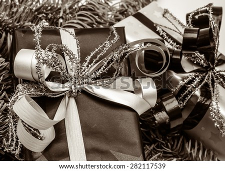 Luxurious christmas presents with decoration, vintage toned - stock photo