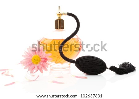 Luxurious classic perfume bottle atomizer with flower blossom isolated on white background. Feminine beauty concept. - stock photo