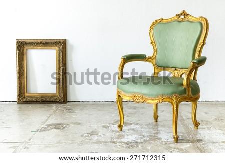 Luxurious classical vintage armchair with empty classic frame on white background - stock photo