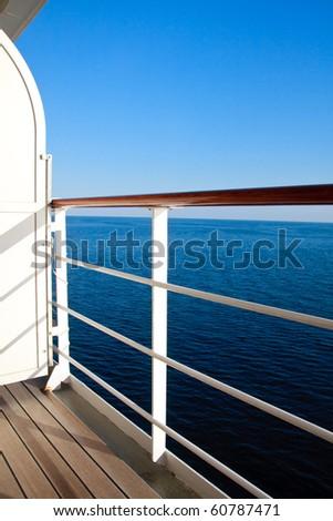 Luxurious cruise ship balcony view on blue ocean - stock photo