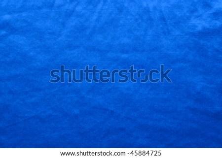 Luxurious deep satin/silk folded fabric, useful for backgrounds - stock photo