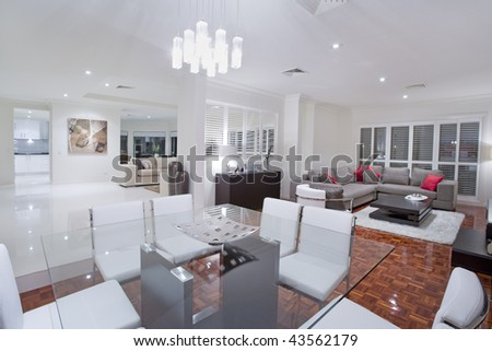 Luxurious dining room with living rooms and kitchen in the background