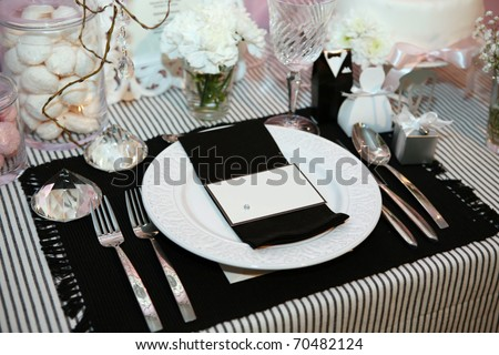 Luxurious dinner in black and white with name tag in the plate - stock photo