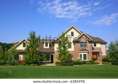Luxurious executive home with blue sky - stock photo