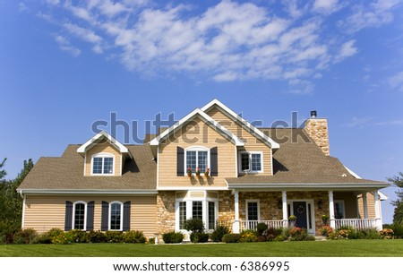Luxurious executive mansion with blue sky - stock photo