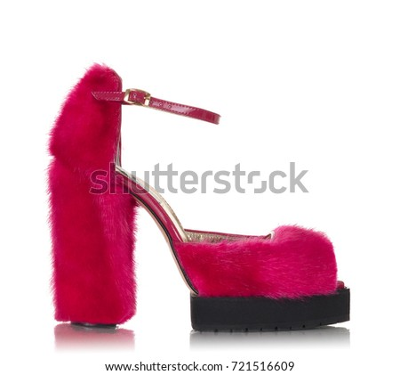 Luxurious female pink shoe of fur close-up of high-heeled with clipping path on white background, side view