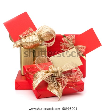 Luxurious gifts with note isolated on white background - stock photo