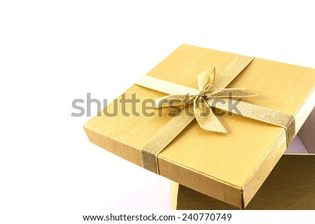 Luxurious gold gift box  on white background