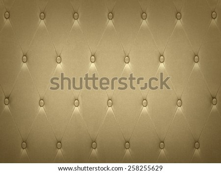 Luxurious golden leather seat upholstery use for background - stock photo