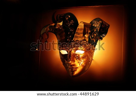 luxurious golden mask on a black background