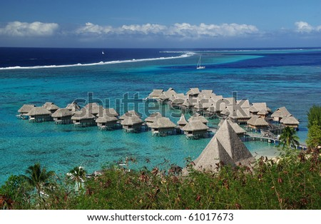 luxurious hotel over a turquoise lagoon in Tahiti, French Polynesia - stock photo