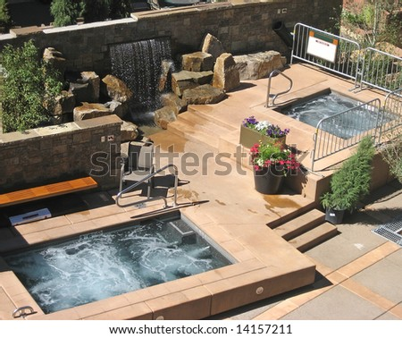 Luxurious hotel patio with hot tubs. - stock photo