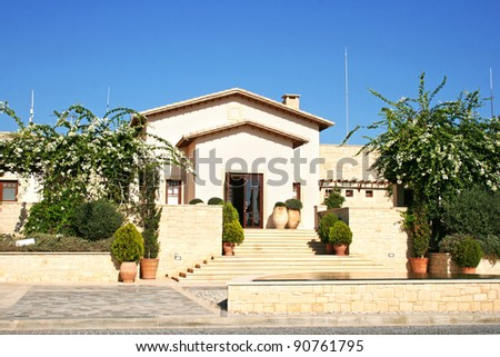 Luxurious house with bougainvillea flowers in Cyprus.