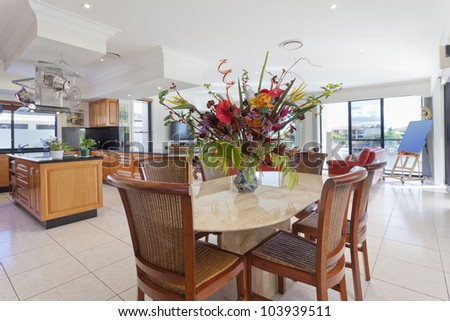 Luxurious kitchen and dining area in mansion - stock photo