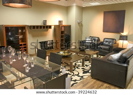 Luxurious living room with black leather sofa and arm chairs. - stock photo