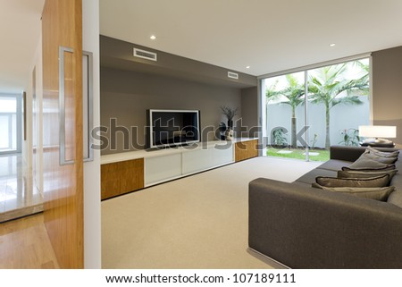 Luxurious media room with Tv and couch - stock photo