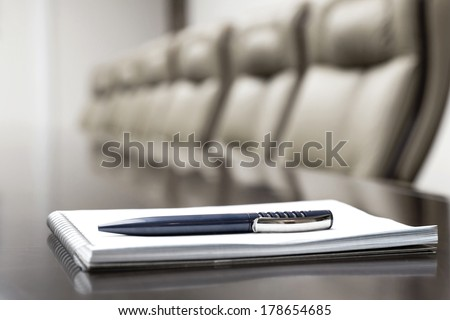 luxurious meeting room in a big corporation is sepia style with agenda notepad for conference - stock photo