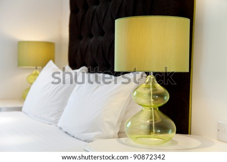 Luxurious modern bed design and bedside lamps - stock photo