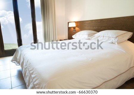 Luxurious modern bedroom with a traditional touch - stock photo