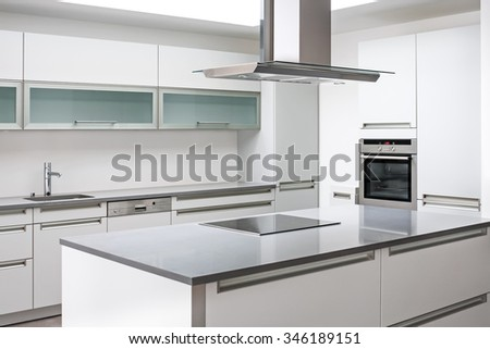 Luxurious modern kitchen with stainless steel appliances - stock photo