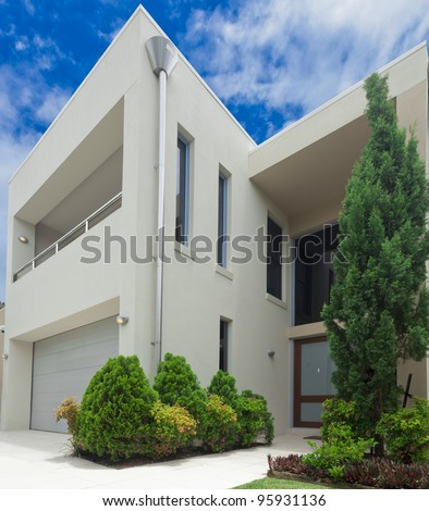 Luxurious modern multilevel house front - stock photo