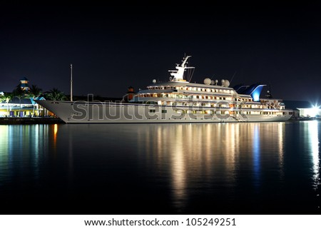 luxurious modern private yacht at the pier at night - stock photo