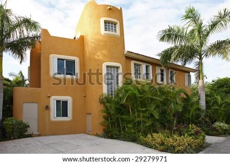 Luxurious modern single family home with tropical garden. - stock photo