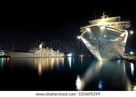 luxurious modern yacht and cruise liner at the pier at night - stock photo