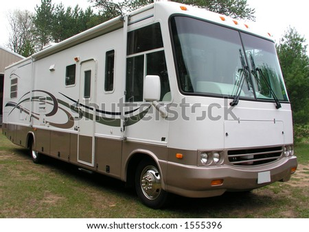 Luxurious motorhome ready for a vacation - stock photo