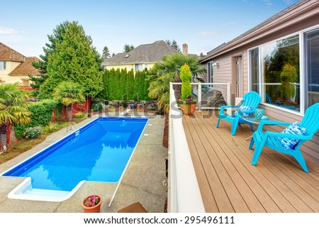 Luxurious northwest home with large pool and covered seating area. - stock photo