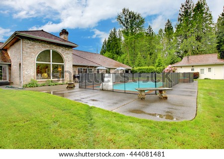 Luxurious Northwest Home With Large Pool And Patio Area. View Of Shed And  Green Lawn