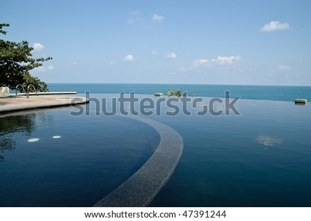 Luxurious open air swimming pool at resort - stock photo