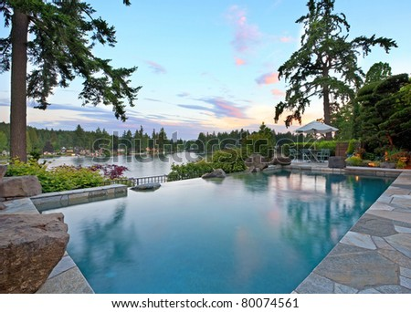 Luxurious Outdoor Pool on Lake - stock photo