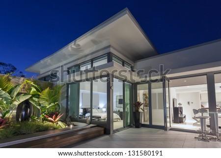 Luxurious penthouse at sunset - stock photo