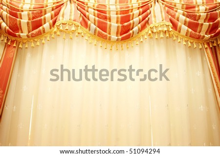 Luxurious red and yellow  curtains as a background. - stock photo