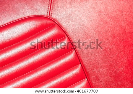luxurious red leather classic car interior closeup in sunlight - stock photo
