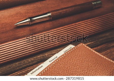 Luxurious rollerball pen and desk pad  - stock photo