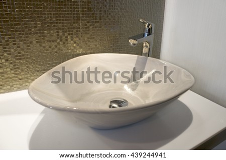 Luxurious  ron sparks green gold mosaic and sink on bathroom at Pattaya, Thailand. - stock photo