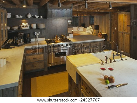 Luxurious Rustic Fully Equipped Log Cabin Kitchen. - stock photo